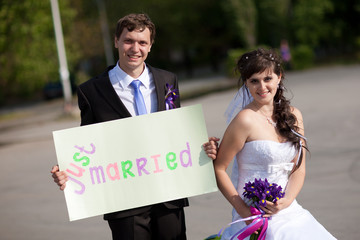 "couple with blank ""just married"""