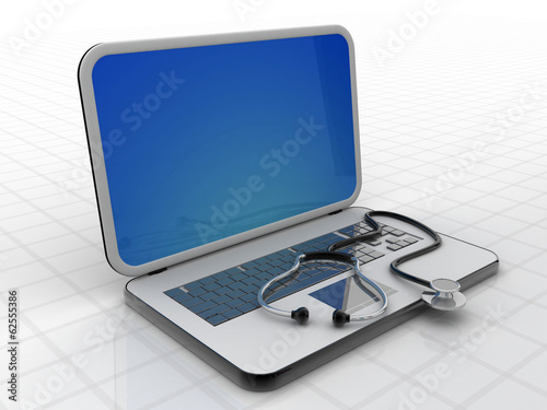 Medical stethoscope on a laptop computer