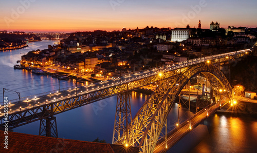 Oporto at river Douro and Dom Luis bridge after sunset