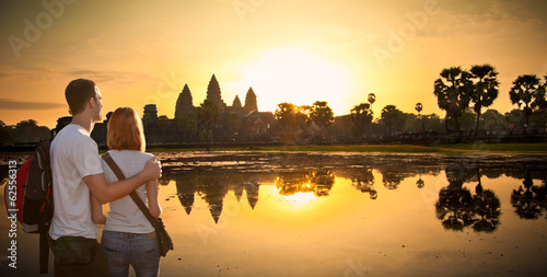Couple at Angkor Wat temple in sunrice, Cambodia.