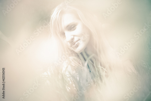 Toned blurred portrait of beautiful blonde woman