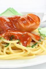 Sausage with pasta and tomato sauce