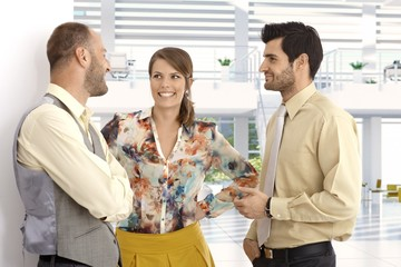 Happy business people at high tech office lobby