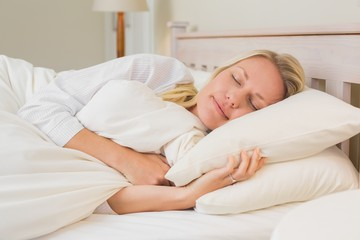 Woman sleeping in bed at home