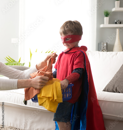 Superhero helping out with laundry