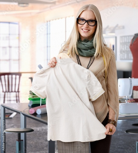 Portrait of happy blonde fashion designer woman