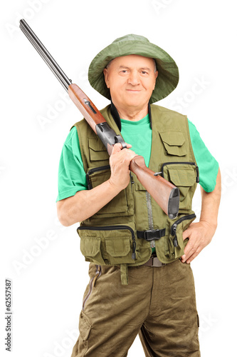 Male hunter holding a rifle