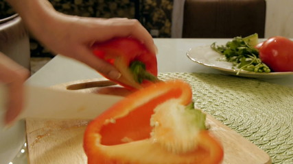 Slicing pepper in the kitchen