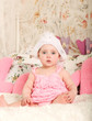 very sweet little child sitting like a princess in funny costume