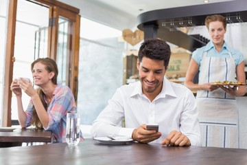 Smiling people sitting in coffee shop