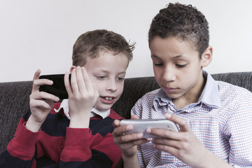 Children playing games on smartphones