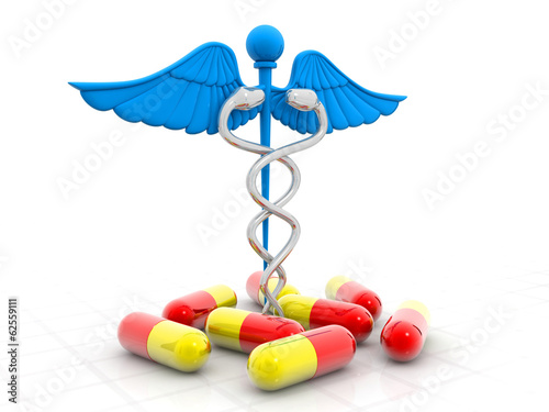 Medical symbol (Caduceus) with pills.