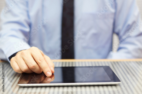 businessman using tablet computer on desk