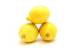 Bright lemons on a white background lie on each other