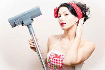 funny young pinup woman with vacuum cleaner
