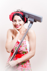 Pinup woman and hoover