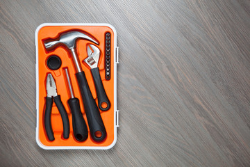 orange tools box against wooden background