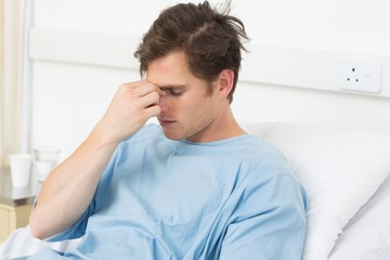 Patient suffering from headache relaxing in hospital