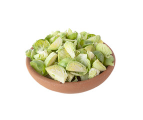 Halved Brussels sprouts in ceramic bowl