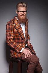 laughing fashion man with long beard and cool hairstyle