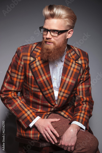 smiling fashion man with beard and nice hairstyle