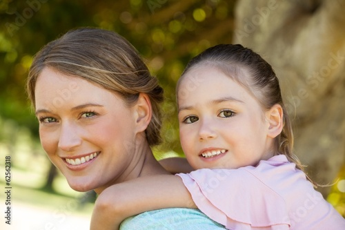 Happy mother and daughter at park