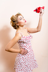 funny pinup woman playing with toy airplane