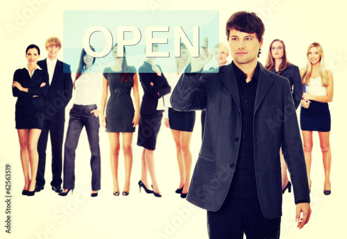 Businessman pushing OPEN on a touch screen interface.