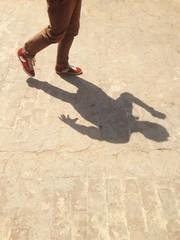 man running pose shadow