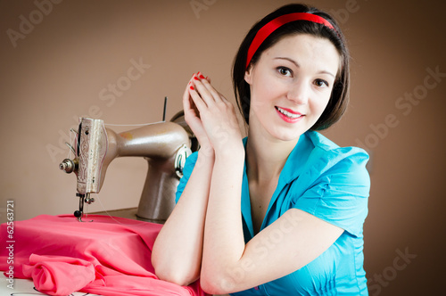 beautiful young pinup woman sewing