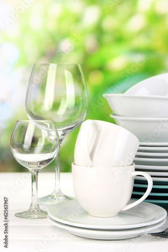 Clean dishes on table on natural background