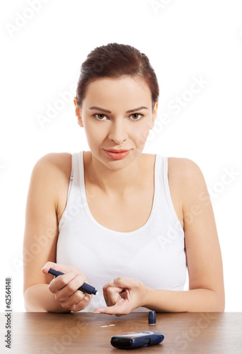 Woman taking sugar level test