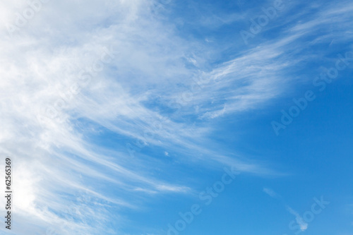 Natural background texture of bright blue cloudy sky