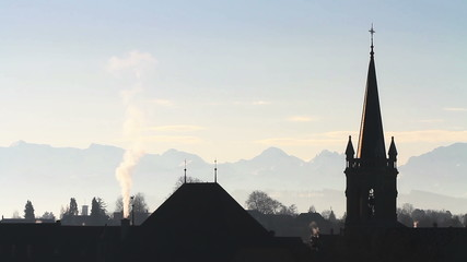 Roofs and chimneys in Bern, backlight