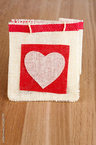 Gift bag on wooden background