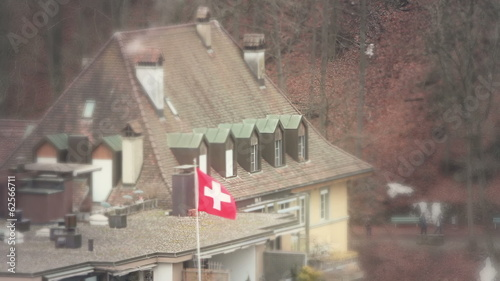 Swiss Flag over a roof in Bern