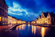 Ghent canal, Graslei and Korenlei streets in the evening. Ghent,
