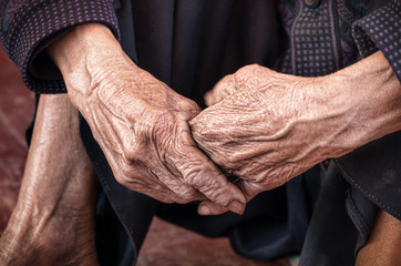 Dramatic hands of an old unidentified Person