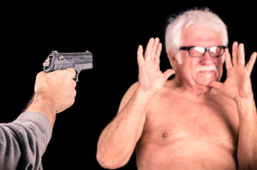 Criminal theratening scared old man with a Gun