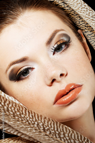 Beautiful woman with brown professional make-up