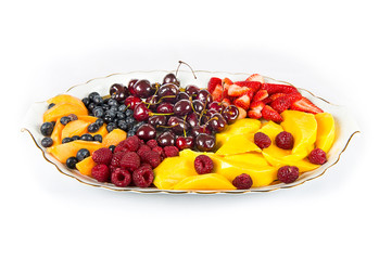 Plate with several fruits over white background