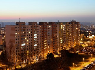 Housing development at sunset. Block of flats at night.
