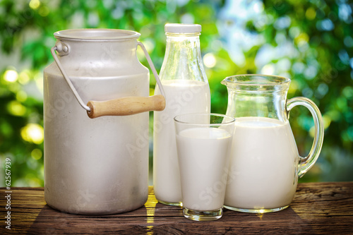 Milk in various dishes. - 62567939
