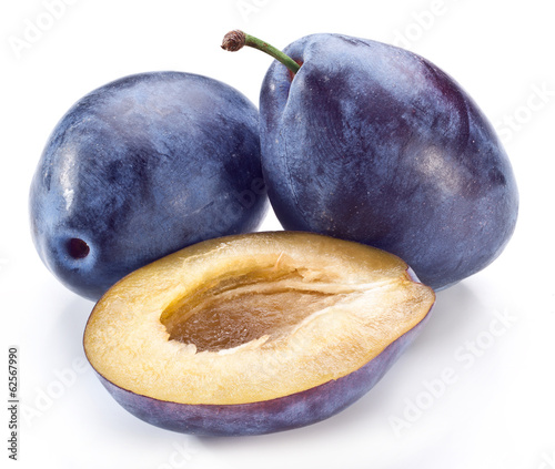 Plums with half of one.
