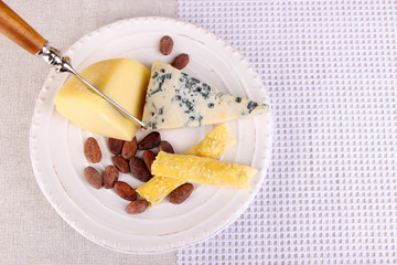 Assorted cheese plate, cocoa beans and grape