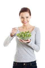 Woman eating lettuce.