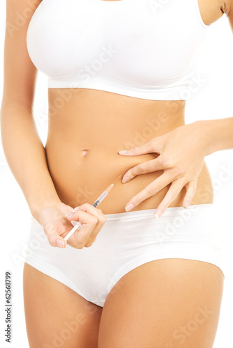 Diabetes woman patient make an abdomen insulin injection