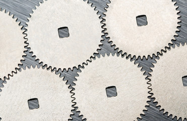 Partnership. Connected metal cogwheels background, a concept for
