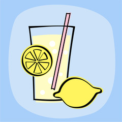 Lemonade in glass and lemons