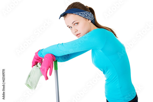 Exhausted cleaning woman